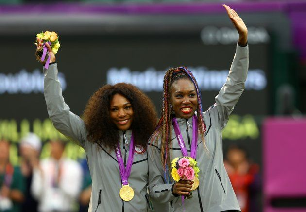 Gold medalists Serena Williams of the United States and Venus Williams of the United States celebrate on the podium during the medal ceremony for the Women's Doubles Tennis on Day 9 of the London 2012 Olympic Games