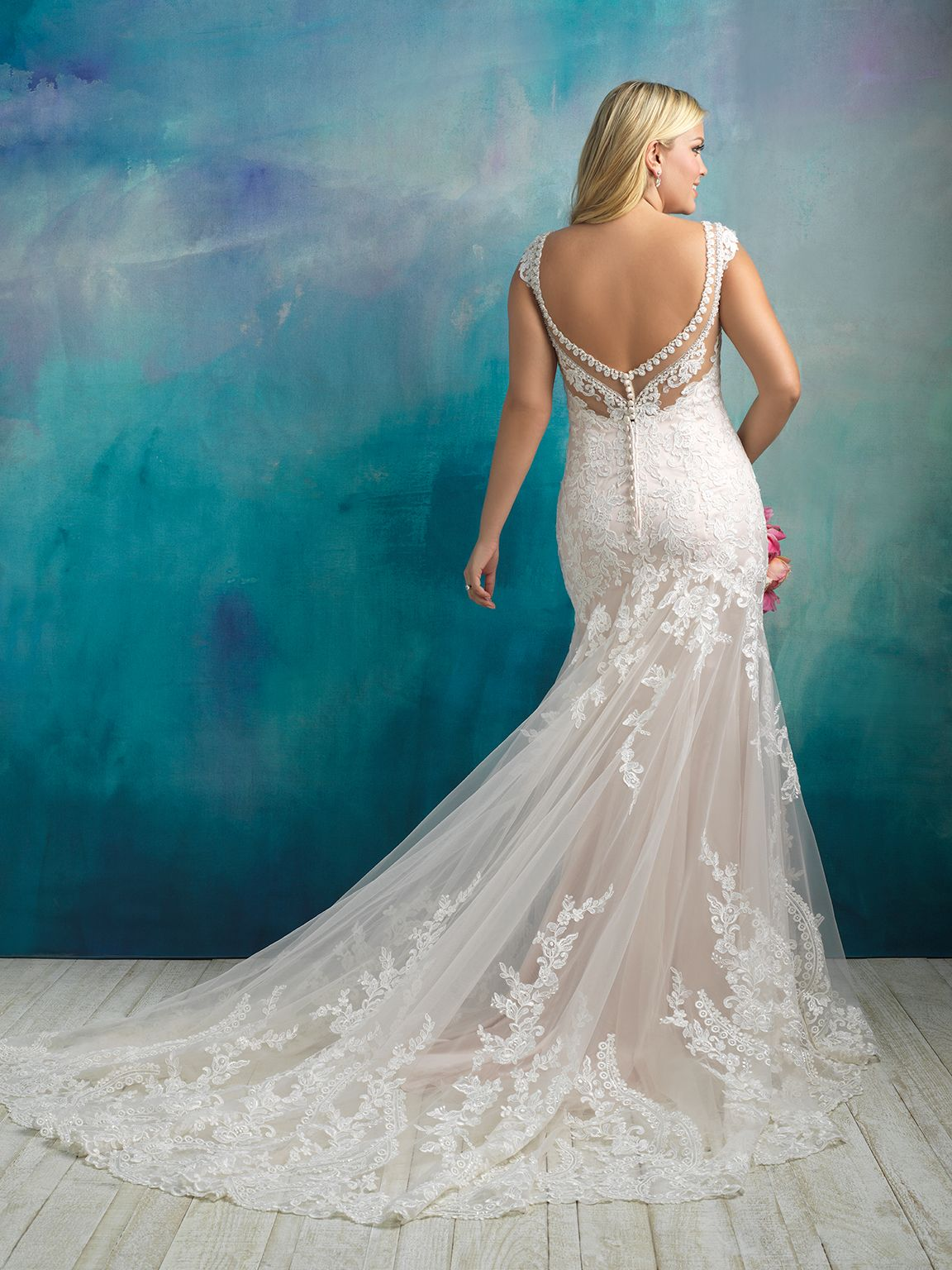 Style: W411 The deep neckline and back of this gown are overlaid ...