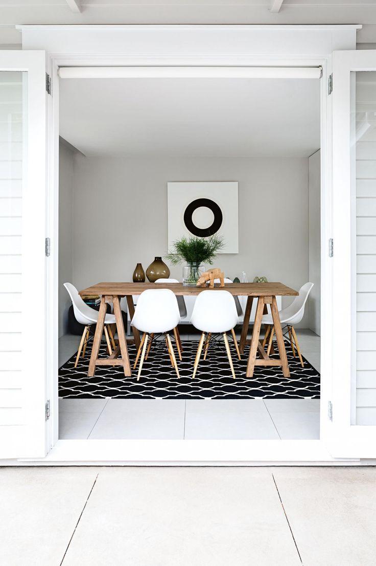 white eames chair rustic table dark rug