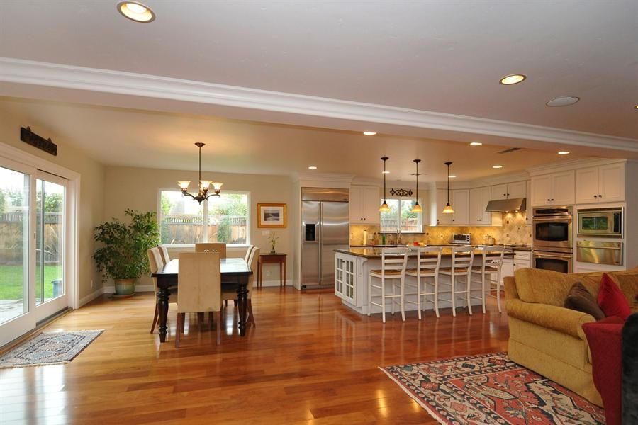 Open floor plan kitchen family room dining room google for House plans with big kitchens and hearth rooms