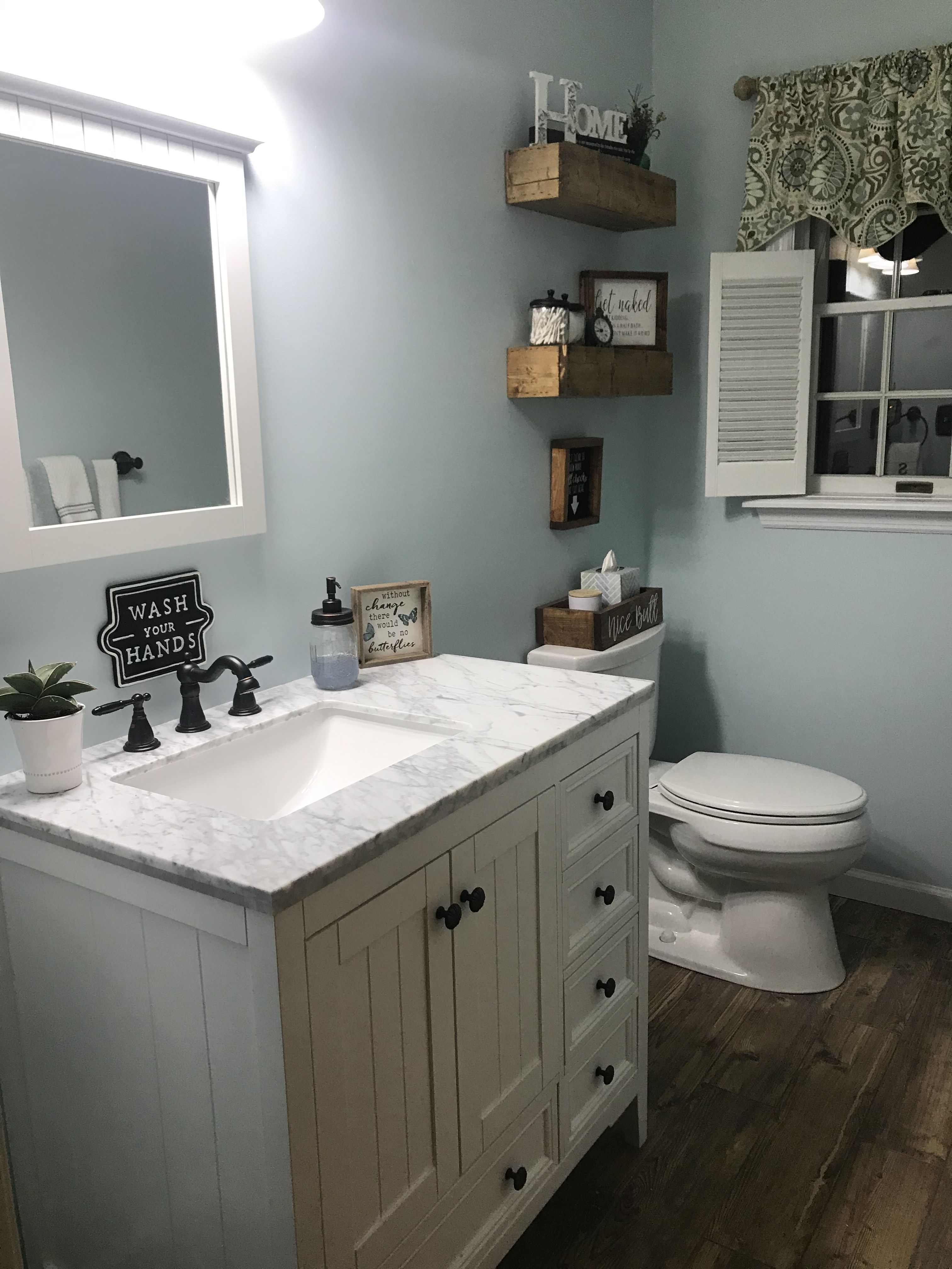 The Vanity is Home Depot, the Light Fixture is Loews the