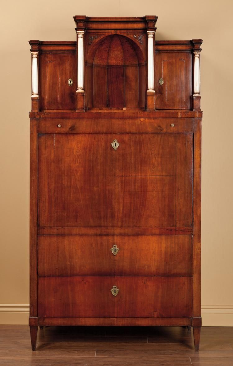 BIEDERMEIER MAHOGANY & FRUITWOOD SECRETAIRE, Austria, c. 1820, The superstructure centered by a birch-lined domed niche flanked by alabaster columns, sided by cupboard doors fronting interiors with 'secret' compartments, above a full width drawer and fall-front panel housing a mirrored architectural interior fitted with small drawers and pigeonhole compartments, and ebonized Egyptian terminals, the base fitted with three tiers of full width drawers, raised on tapering squared supports. 81…