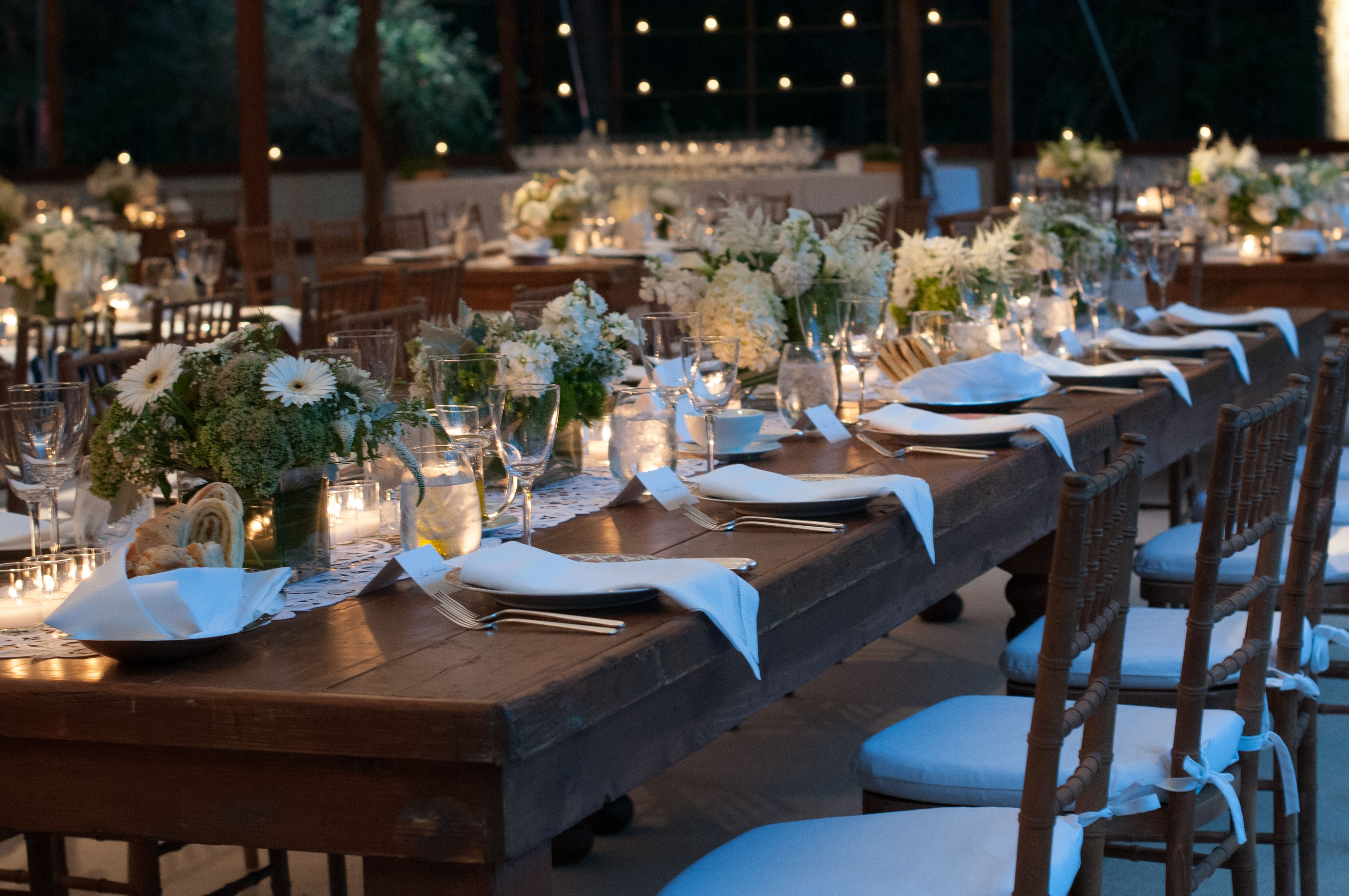 long table setup wedding reception%0A Farm table setting  white and green floral centerpieces  Irish linen  napkins  various colored
