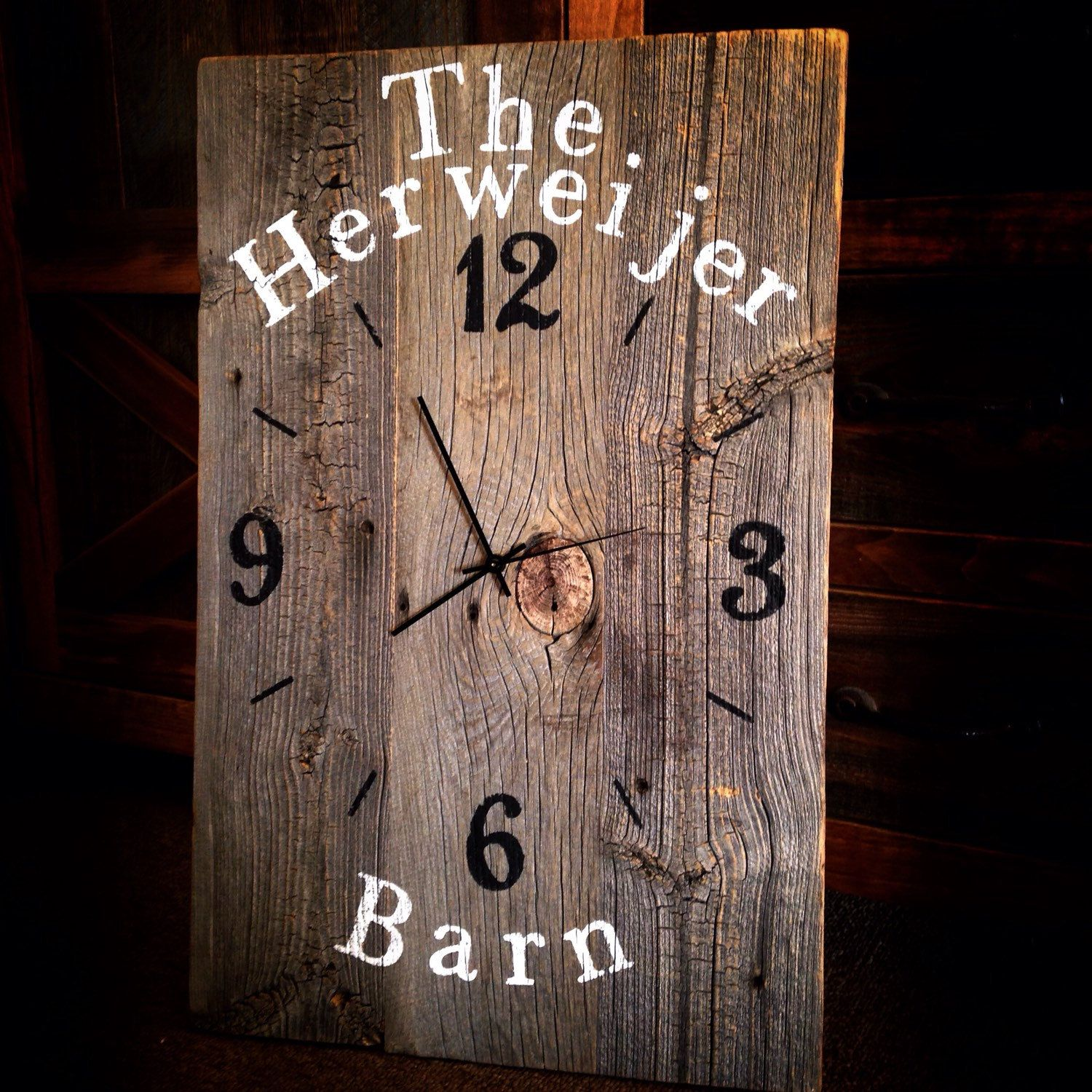 This rustic reclaimed barn wood clock will