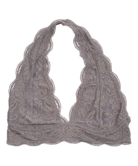 This lacy bralette highlights your neckline with its halter design and soft hue.