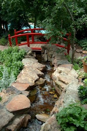 Garden bridges are great.  I love that this one is red.