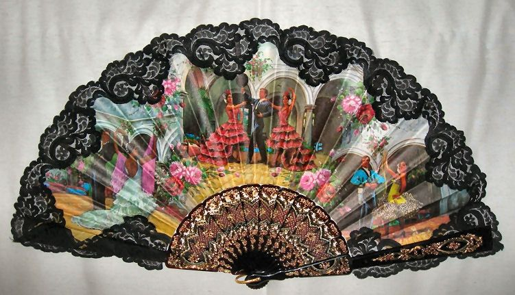 """Large fan- Pericon printed fabric trimmed with lace mounted on plastic.   Flamenco Dancers.  Size: 13 1/2"""" X 25"""""""