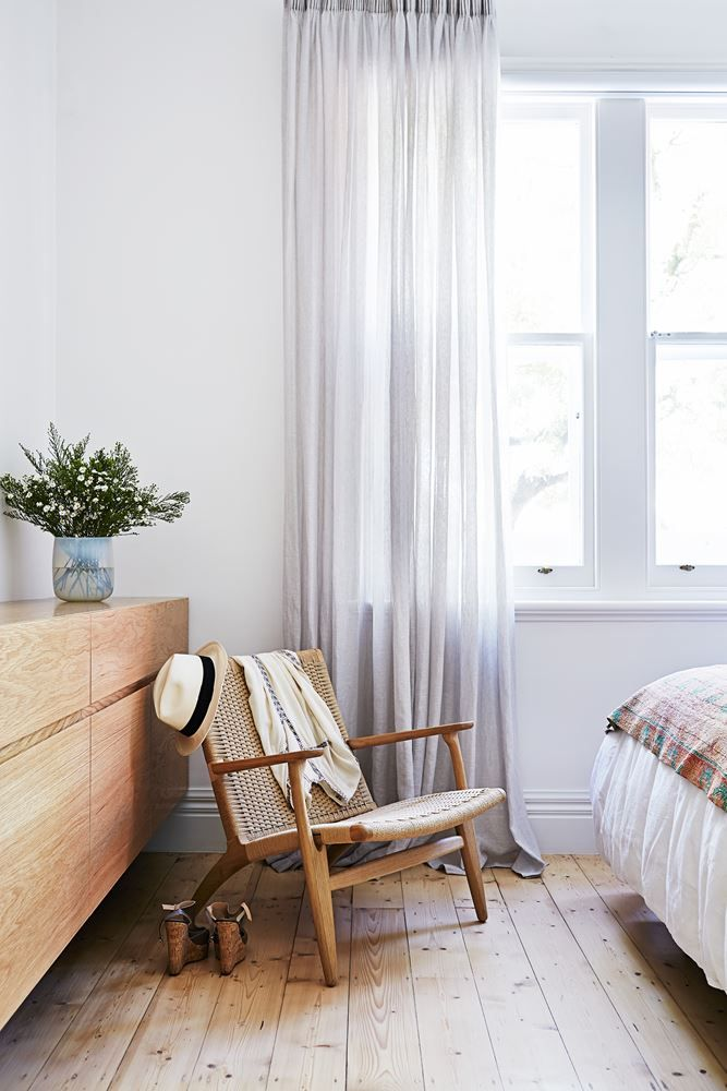 Sheer linen curtains form part of the timeless