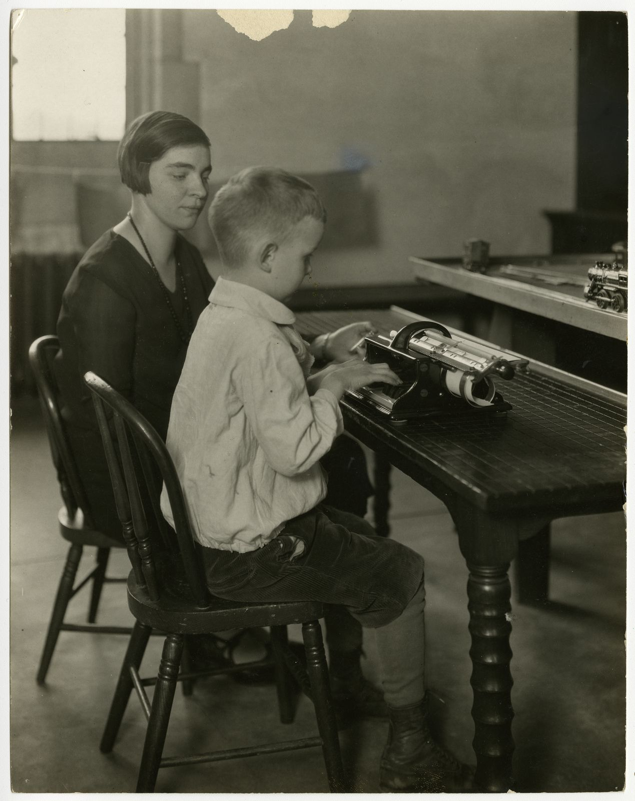 Student writing on a brailer, Perkins Institution for the Blind, 1929