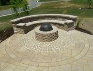 Paver patio with grill wall enclosure, steps, seating wall, firepit, landscaping and lighting.