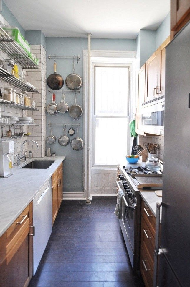 try out this rack technique for hanging your pots pans for the rh pinterest com