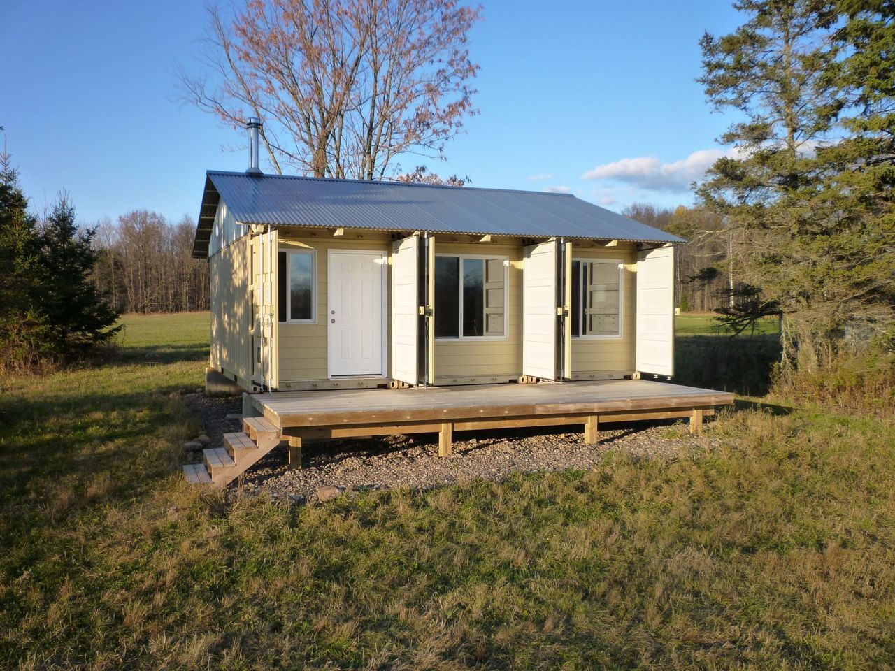the tin can cabin was built from 3 shipping home container rh pinterest com