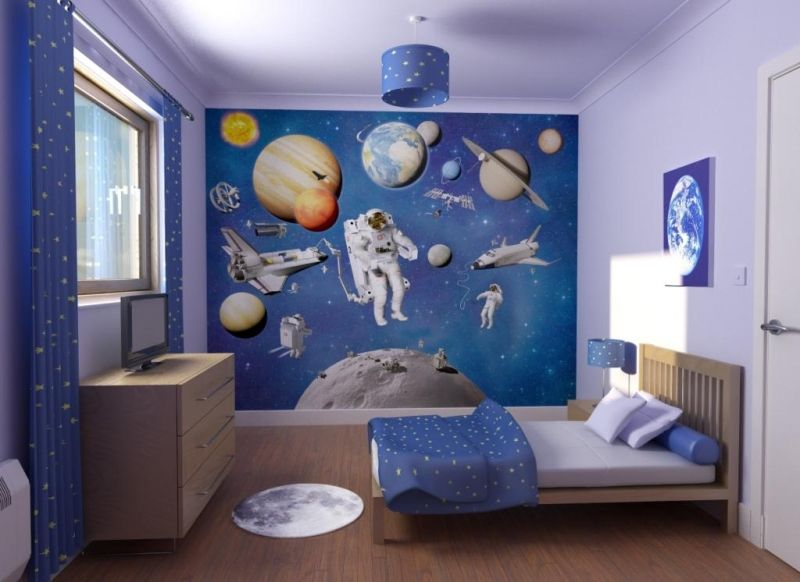 planet and astronaut in outer space themed childs bedroom interior design