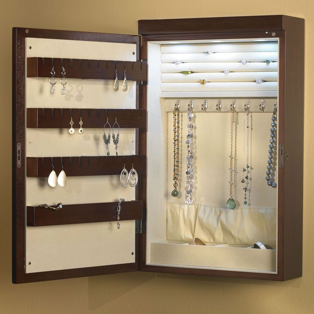 The 24 Inch Wall Mounted Lighted Jewelry Armoire Hammacher