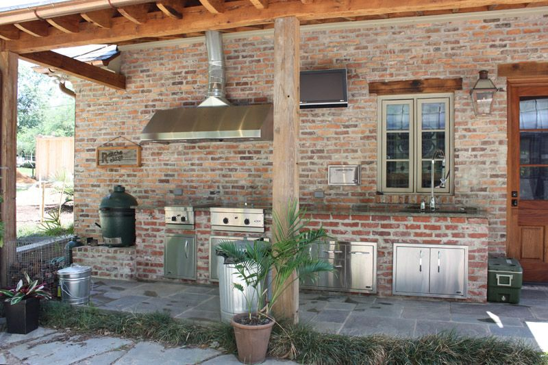 outdoor kitchen with vent hood and stainless steel appliances ...