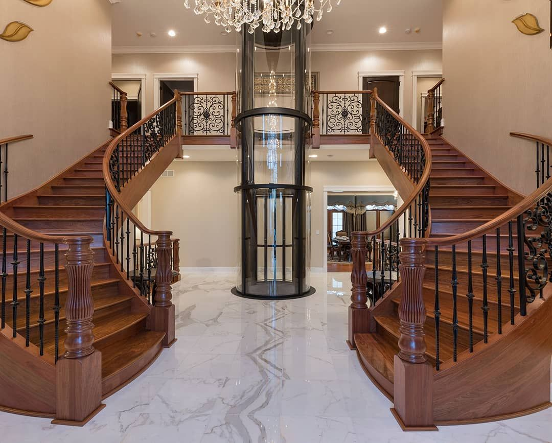 Double Staircase With Pneumatic Elevator Foyer Foyers Staircase