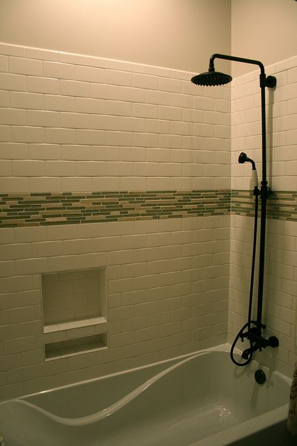 Subway style tiles with mosaic accent  rain shower head and handheld liam s bathtub Shower niche tub Rain