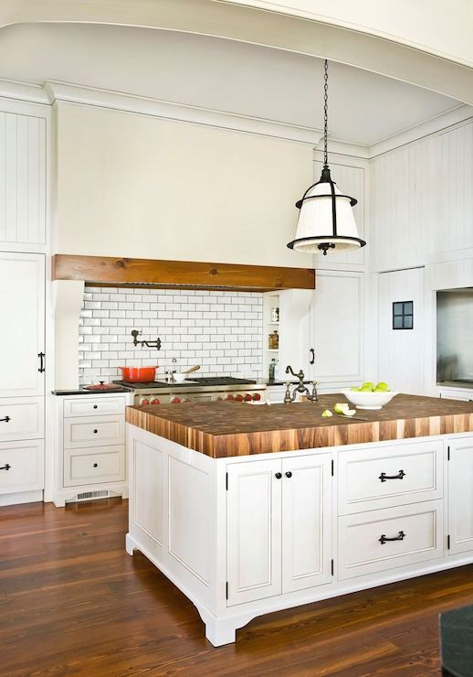 amazing kitchen features walls clad in beadboard trim framing a rh br pinterest com