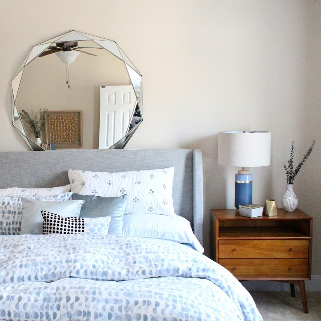 Upholstered Sleigh Bed and Midcentury Grand Nightstand