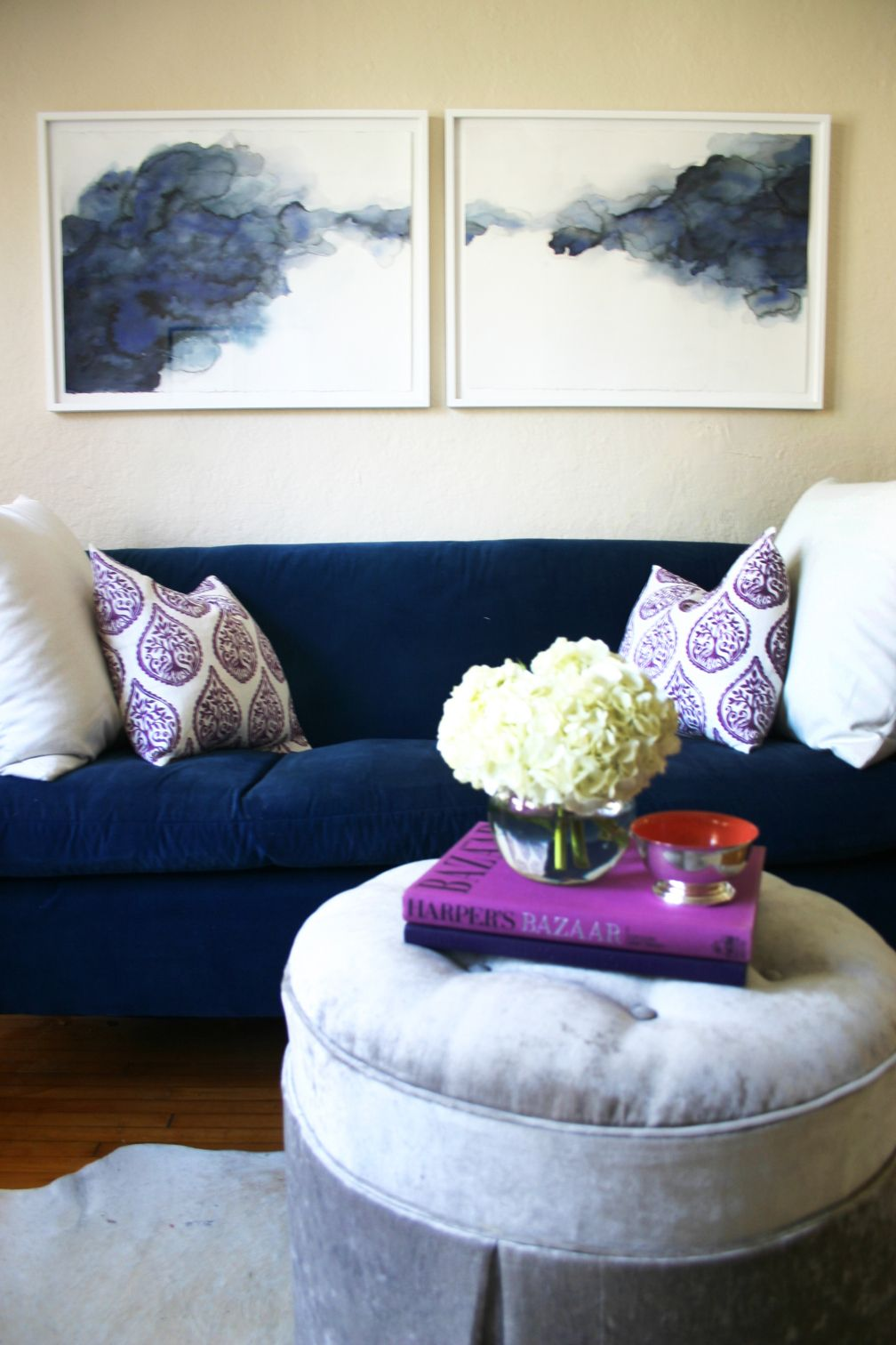 living room in blue%0A Blue velvet sofa  abstract watercolor painting  and a gray crushed velvet  ottoman pops of fuchsia