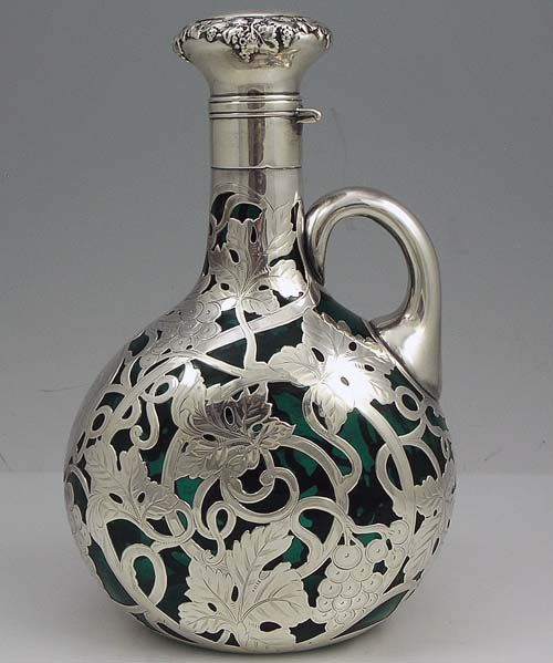An Art Nouveau Silver Overlay Decanter By The Gorham