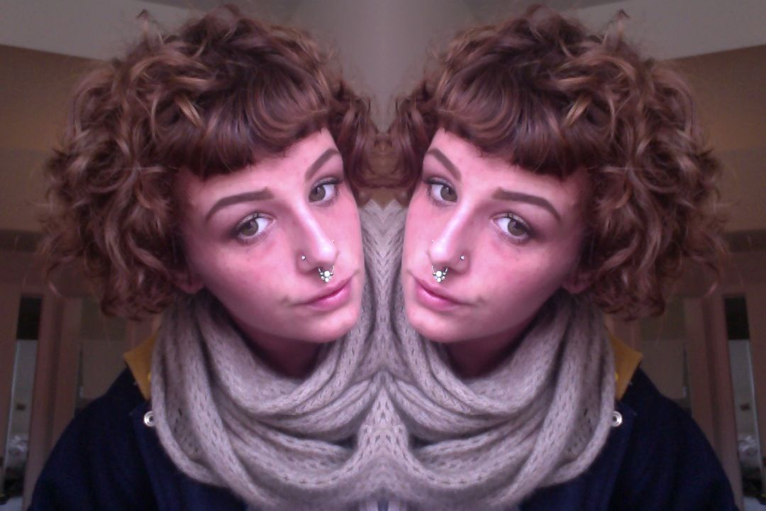 Short Curly Hair With Straight Across Bangs. So Cute