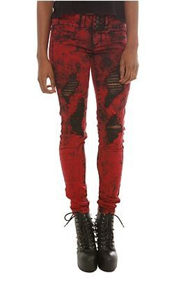 Red skinny jeans with rips