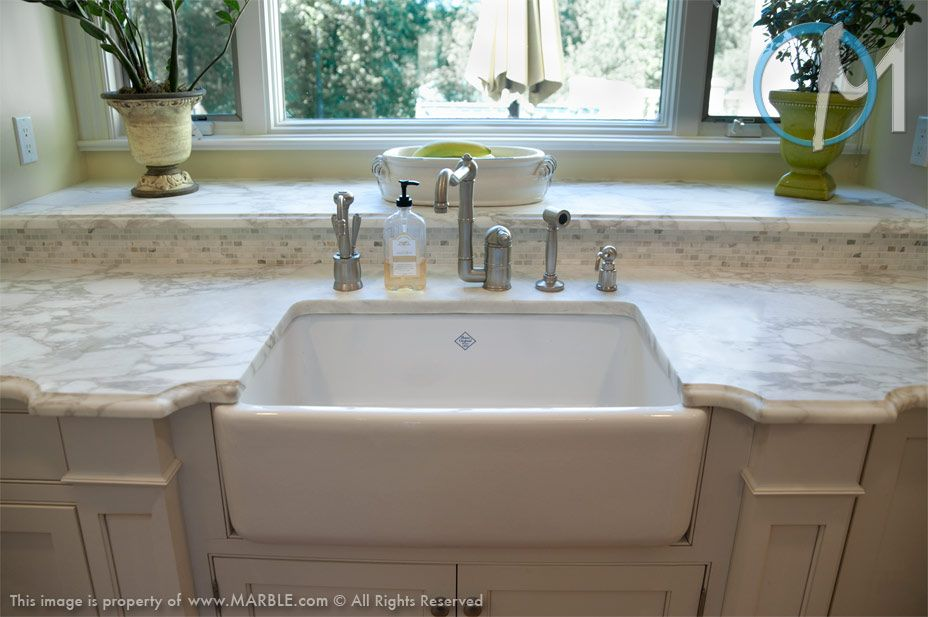 Calacatta Oro S Timeless Look Is Perfect With This Farm Sink Www Marble Com Calacatta Oro Marble Kitchen Window Sill Kitchen Sink Window Kitchen Sink Lighting