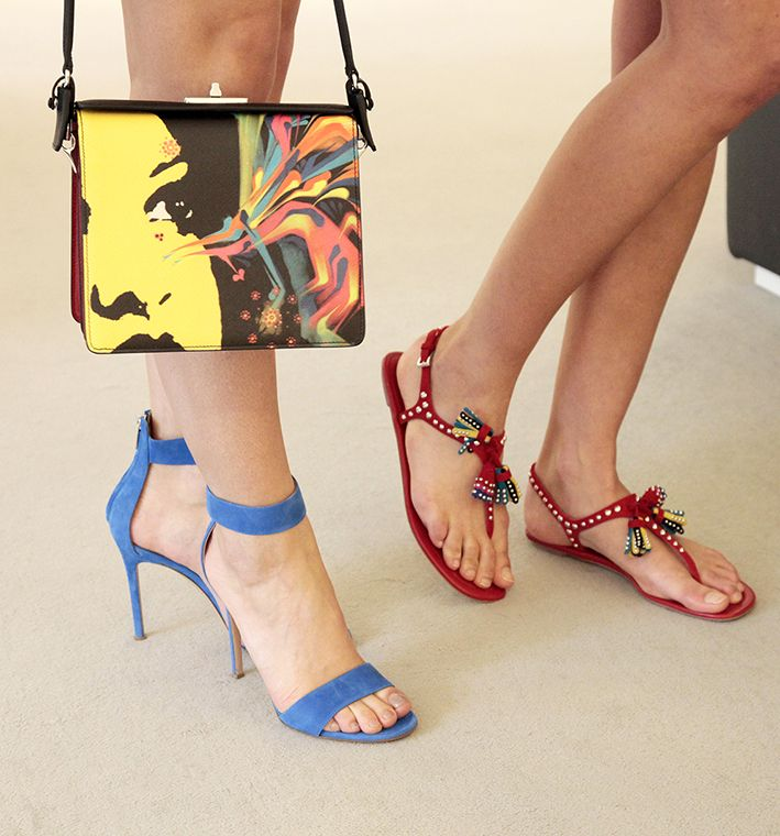 Prada handbag with face illustration, blue suede stiletto sandals ...