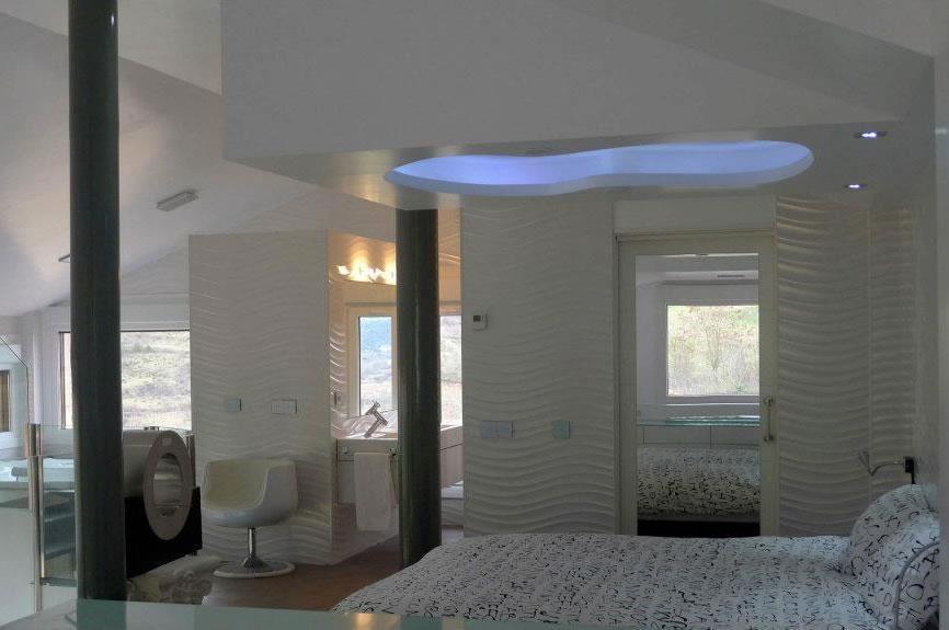 casaruralflavinacom planta superior con dormitorio con luces