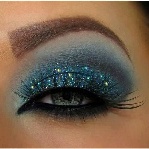 Blue glittery eyes with smoked liner eyes #eye #makeup #bright #dramatic #glitter