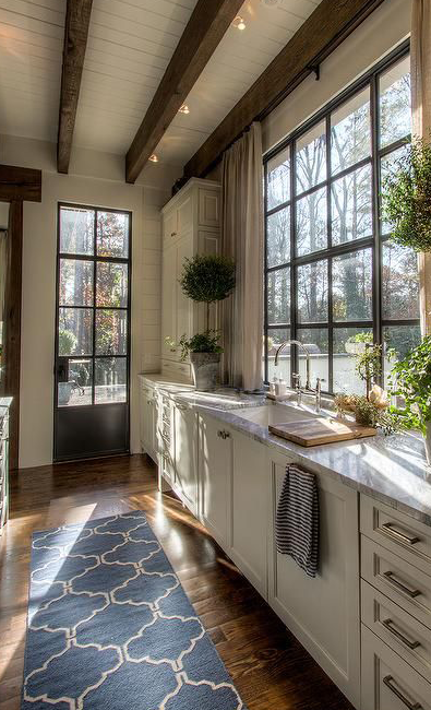 5 ways to make your galley kitchen feel huge galley kitchens kitchen sink window modern on farmhouse kitchen window id=31500