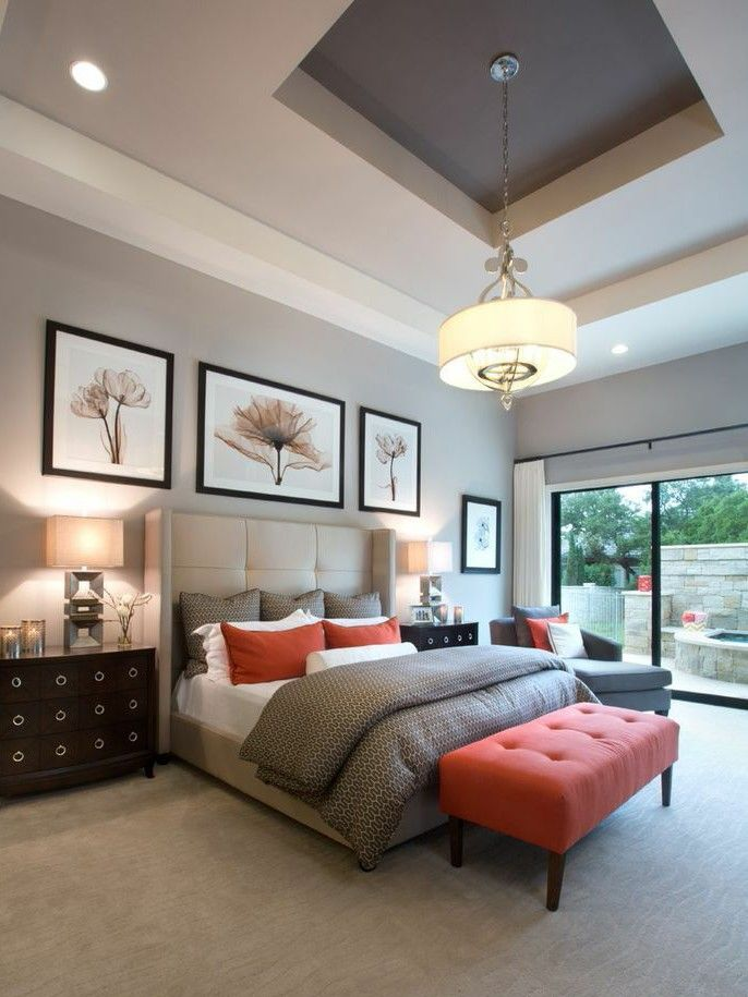dream master bedroom%0A Gray master bedroom with bright brown touches in  Bright brown tufted bench  and throw pillows add pop of color to this neutral bedroom