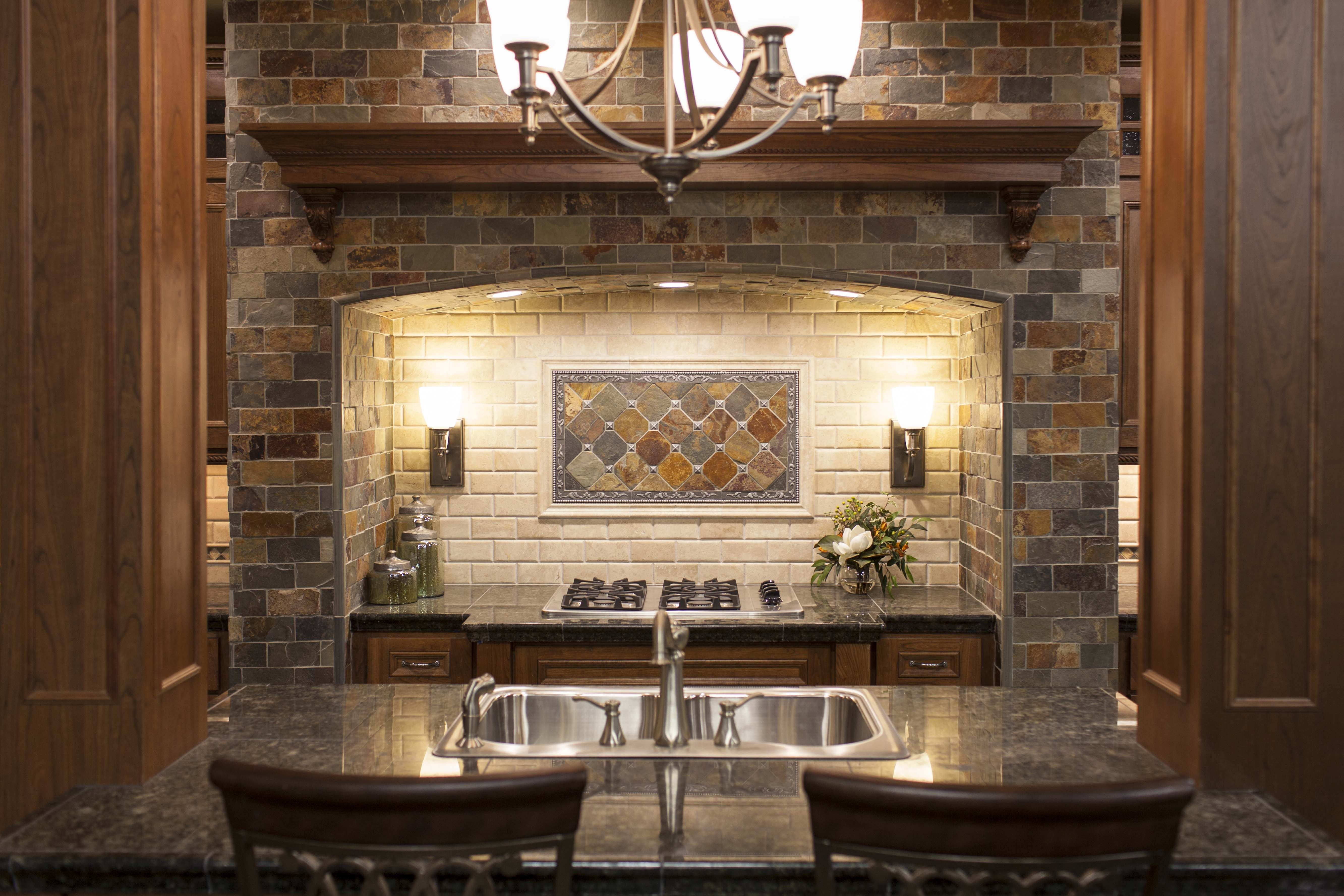 this hearth style backsplash is the focal point of this kitchen