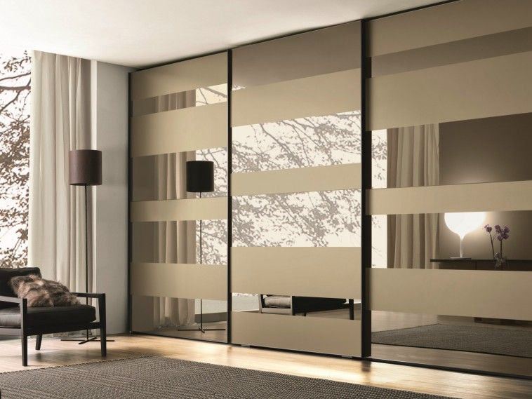 mirrored glass wardrobe with sliding doors mixed with grey carpet on laminated floor with mirrored sliding