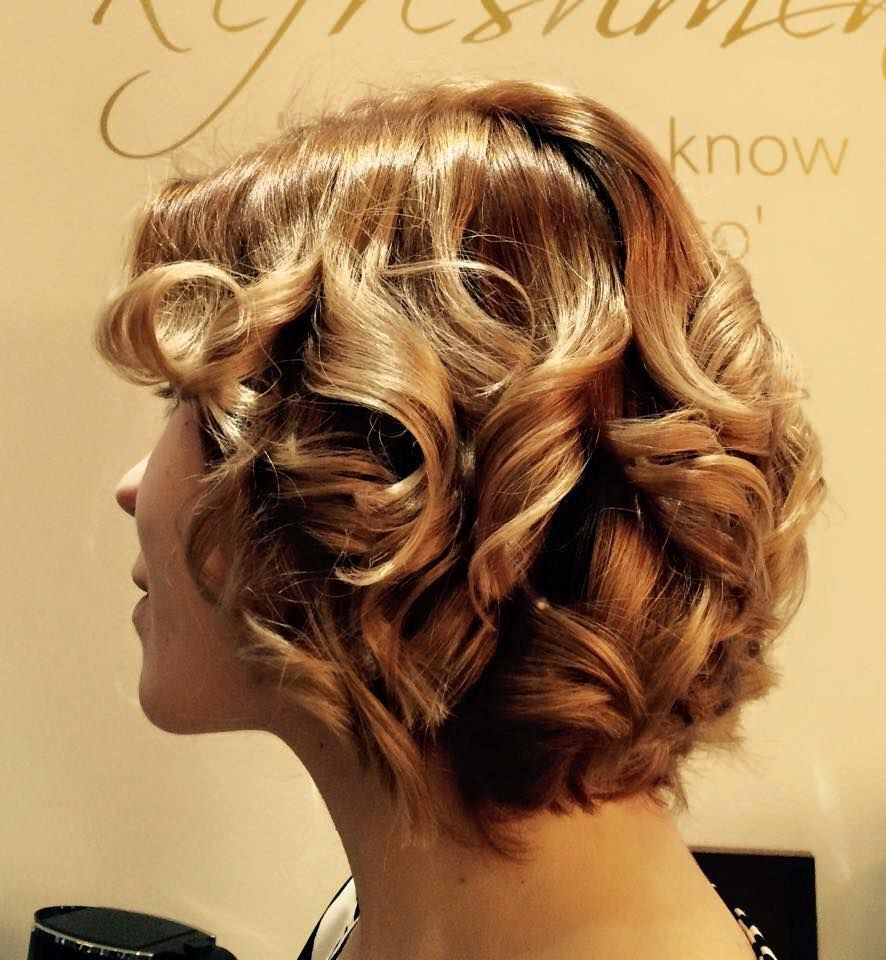 Beautiful curled Hair by our Hair Stylist