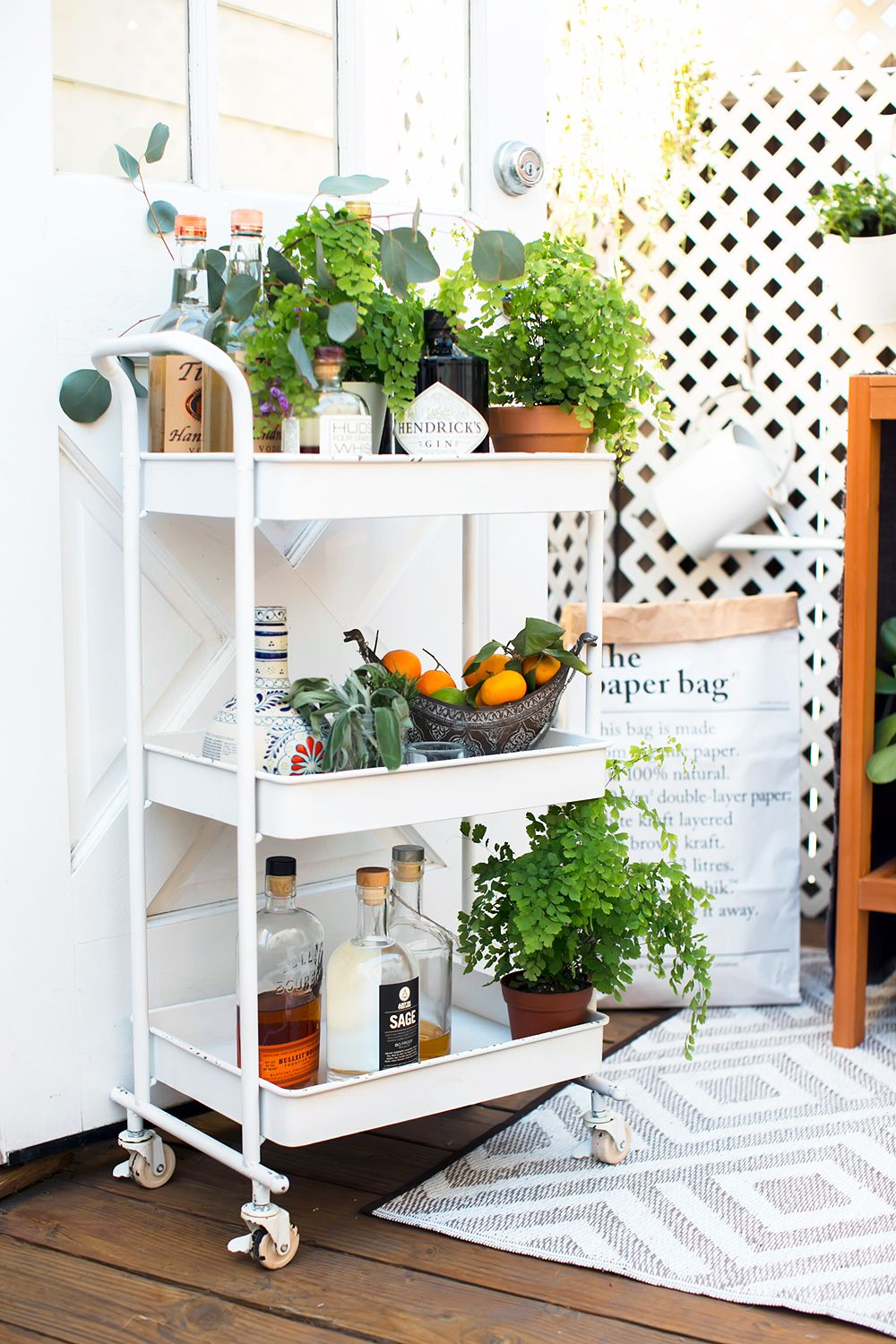 Try Layering Plants On A Compact Vertical Multi Tiered Rolling Bar Cart