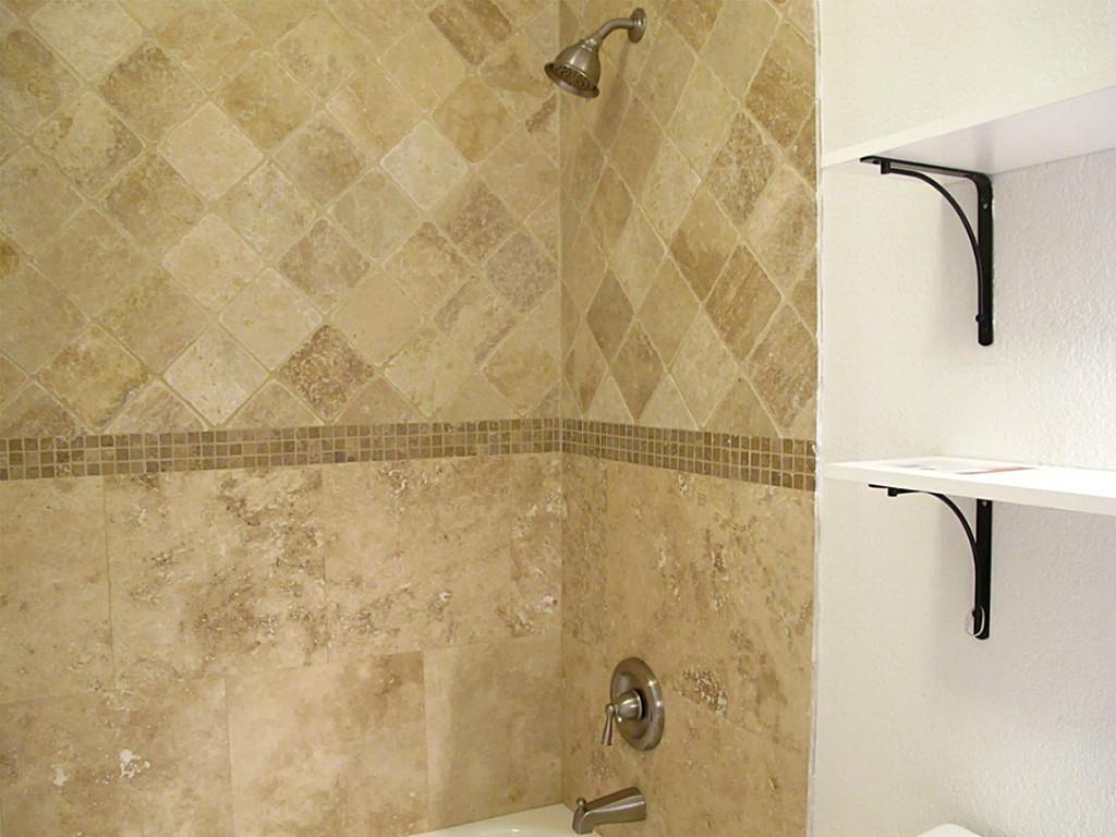 Travertine tile bathtub surround idea - brushed nickel fixtures ...
