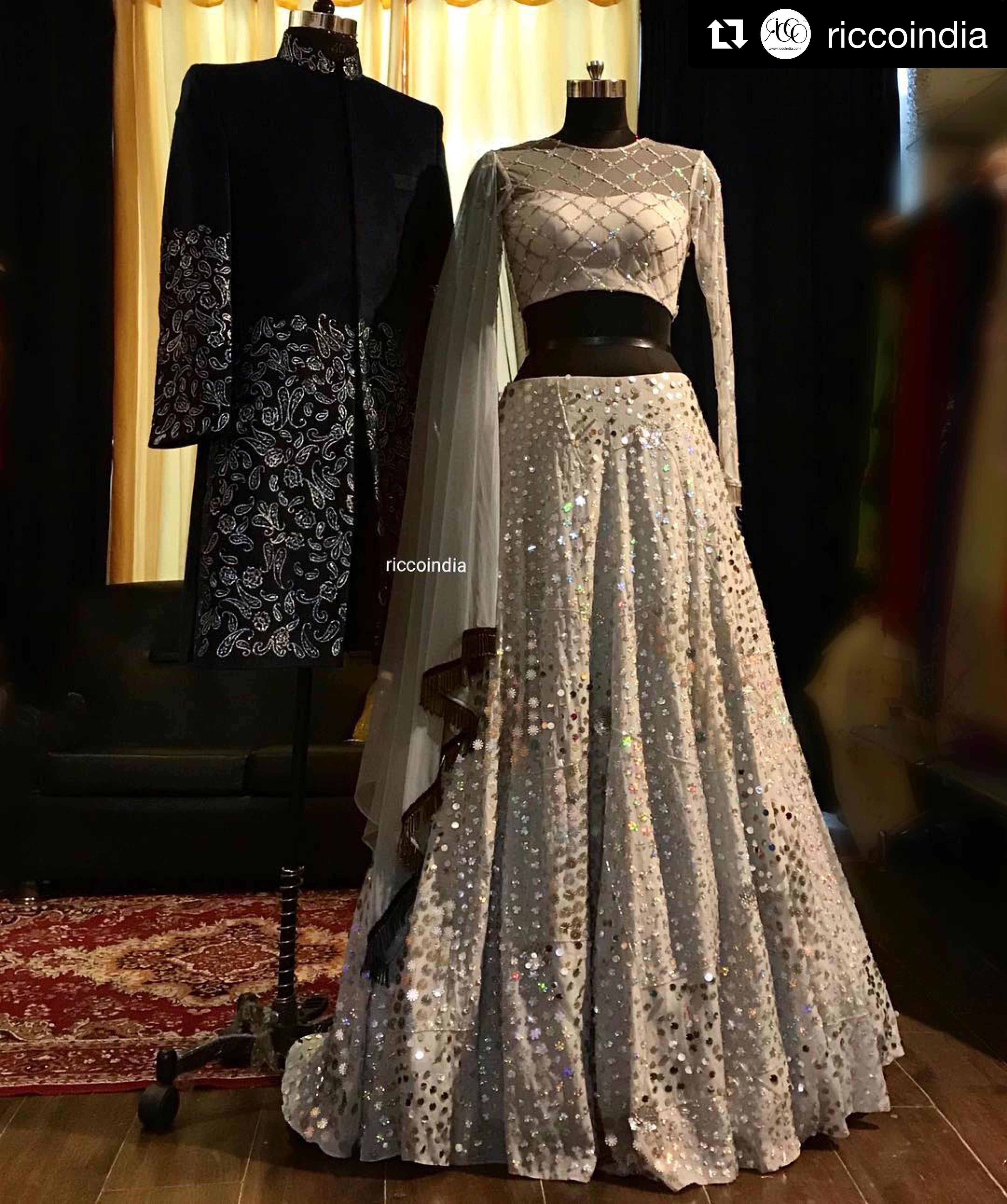 387d5ce7dc5 Silver Lehenga with sequin work and criss cross embroidery blouse for the  Bride. Blue velvet textured sherwani for the groom