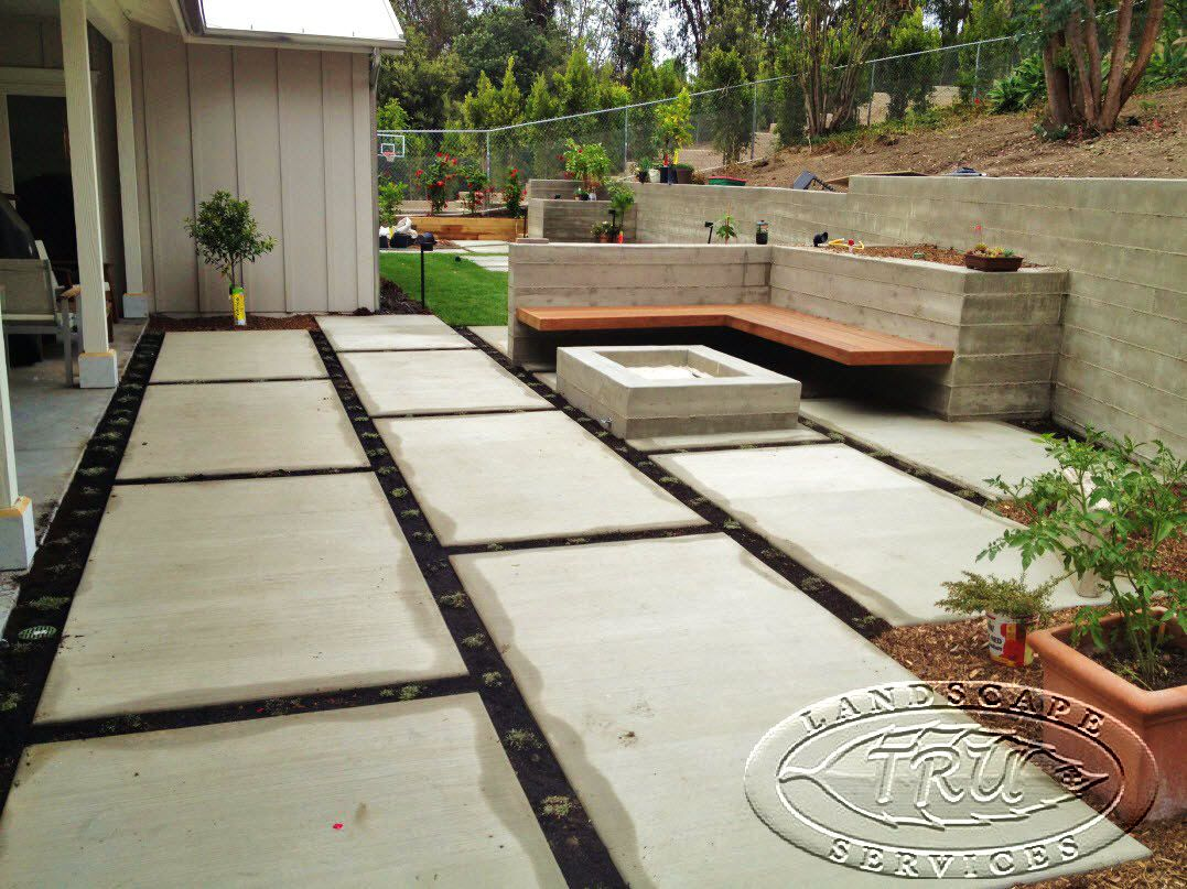 backyard patio area with a custom concrete fire pit and seating rh pinterest com