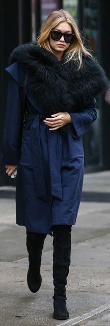 Gigi Hadid's wearing  Coat – Kempner  Sunglasses – Karen Walker