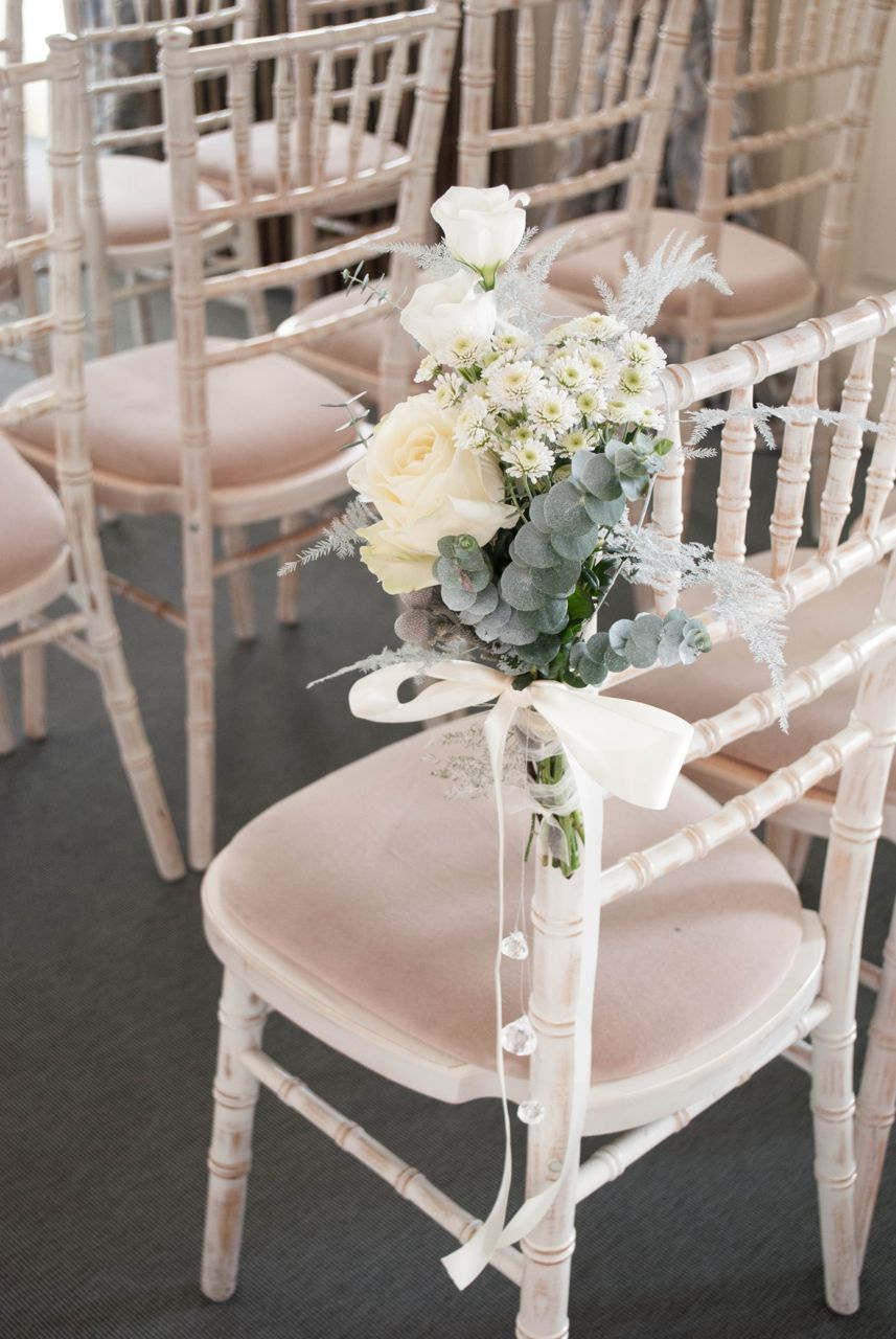 winter wonderland wedding table ideas%0A Ceremony chair flowers  winter wedding flowers  aisle decoration   Flowers by Laurel Weddings