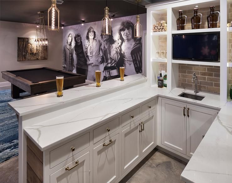 hang out and kick back in this well appointed basement basements rh pinterest com