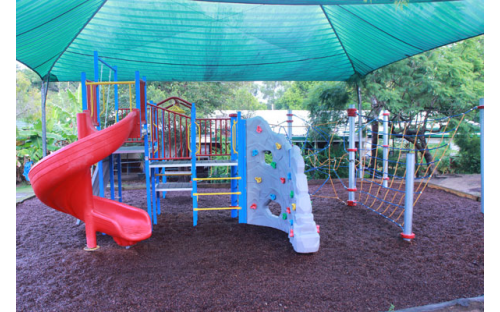 Outdoor playground area with bark soft fall