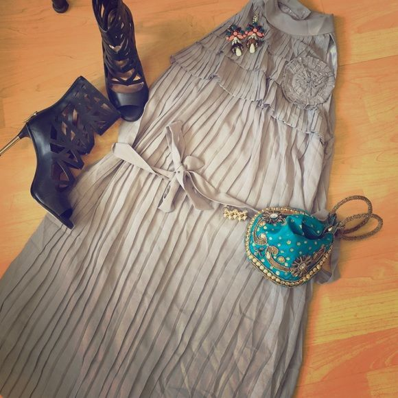 NWOT. Very cute pleated dress with flower accent. Very cute pleated dress with two pearl buttons on the back of the neck. High neck halter style with ribbon. Grey. Accent flower on breast. Dresses