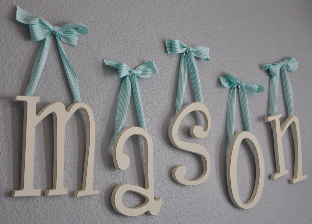 Wooden hanging letters made by New Arrivals