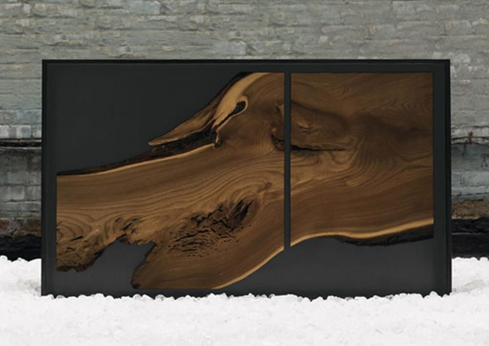 blackened steel + micro slab credenza     Materials:  blackened steel + micro slab Dimensions:  made to order Options:  *This piece is custom made to order - please inquire as to custom options available.