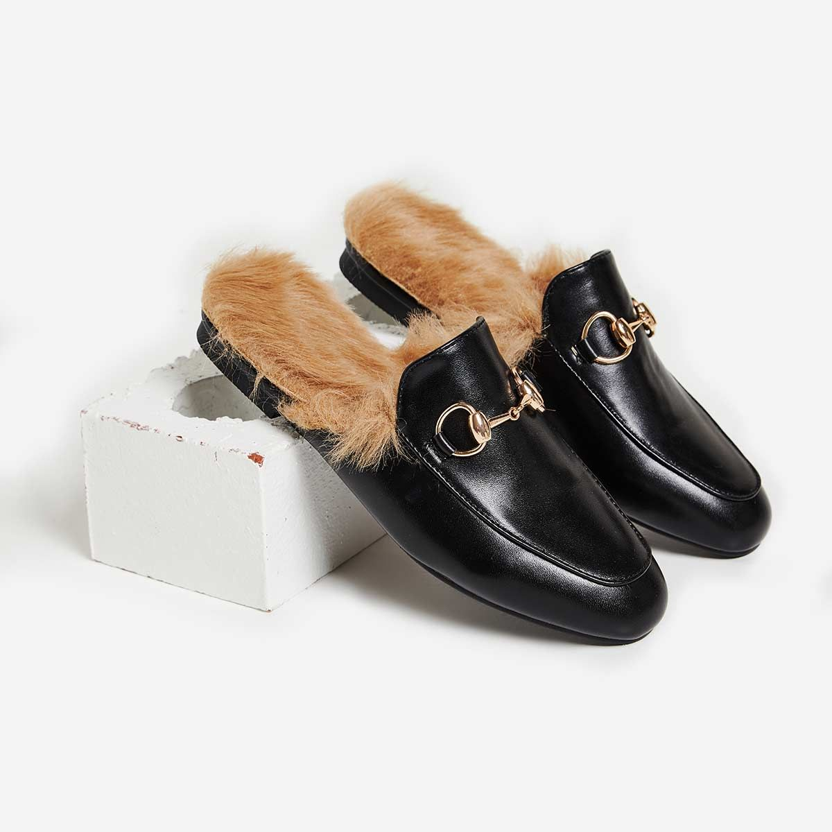 Leona Faux Fur Lined Flat Mule In Black Faux Leather. Available in sizes UK  3