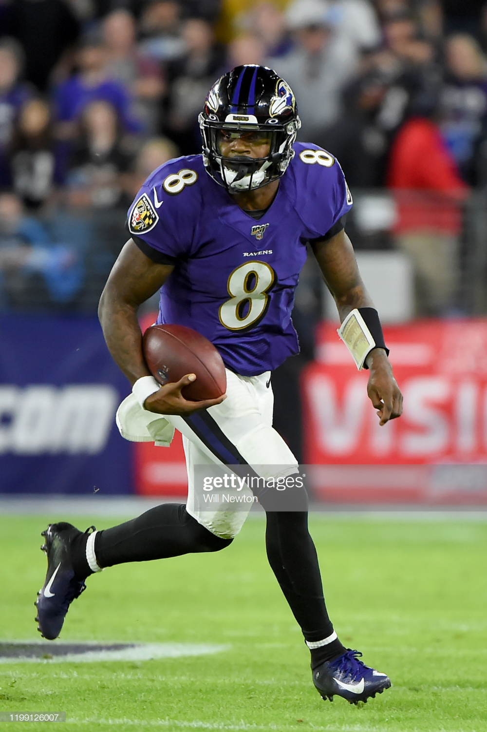Lamar Jackson of the Baltimore Ravens runs against the