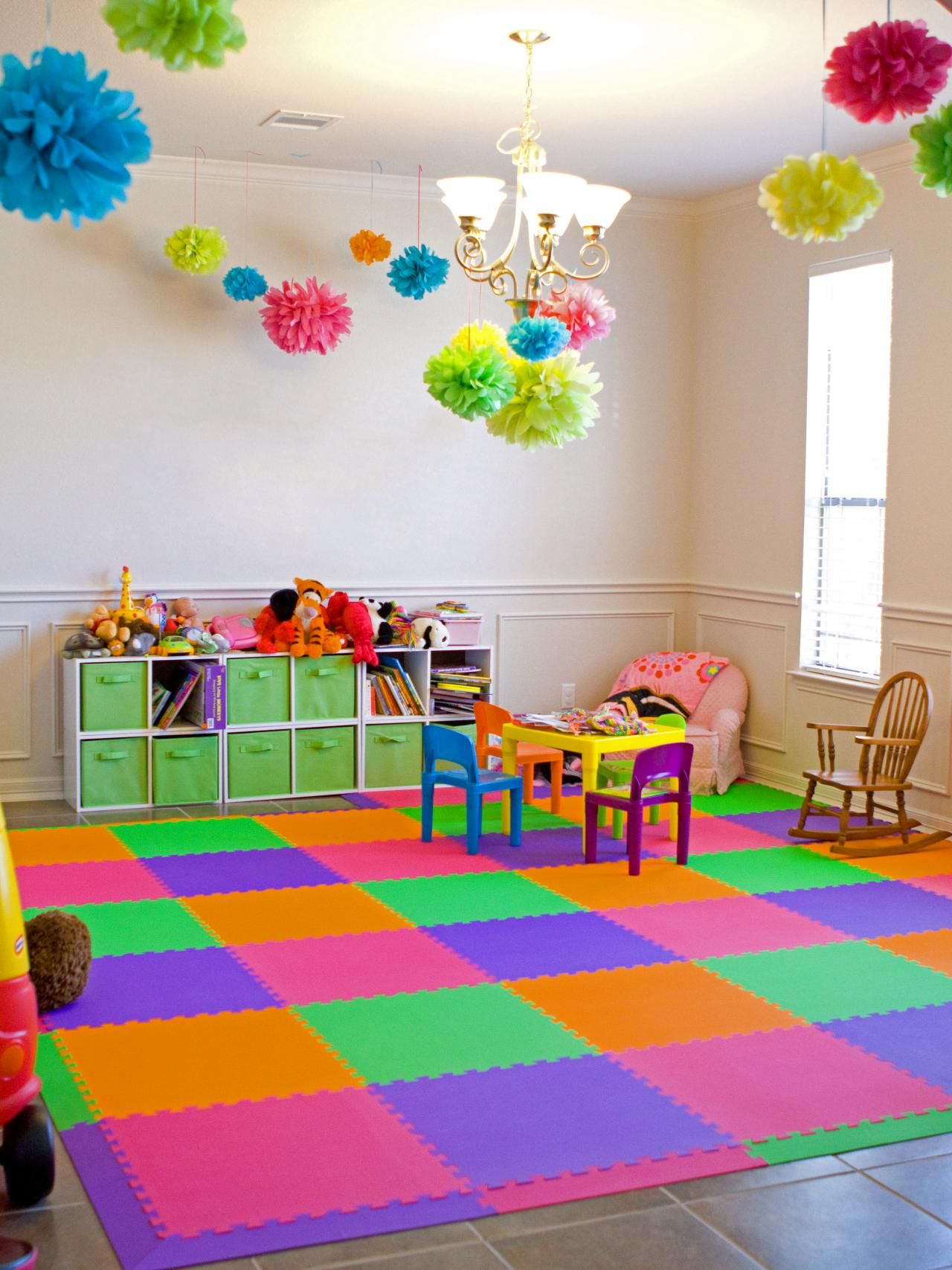 hang tissue pom poms from the ceiling